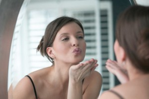 Woman Blowing Herself a Kiss in the Mirror